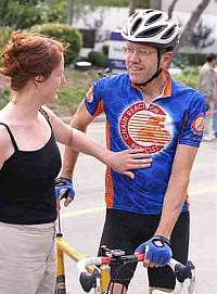 Mike talking to a Courtney at a race.